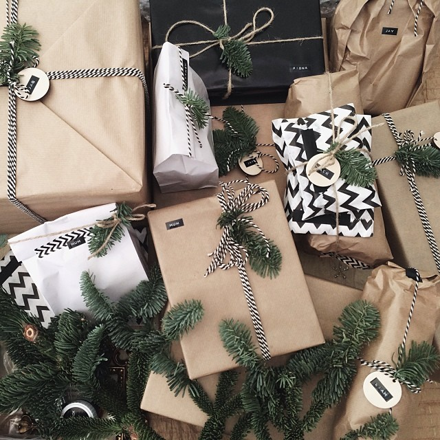 Christmas gift wrapping with pine tree branches, bakers twine, dymo labels, chevron, washi tape and kraft paper | A Living Diary