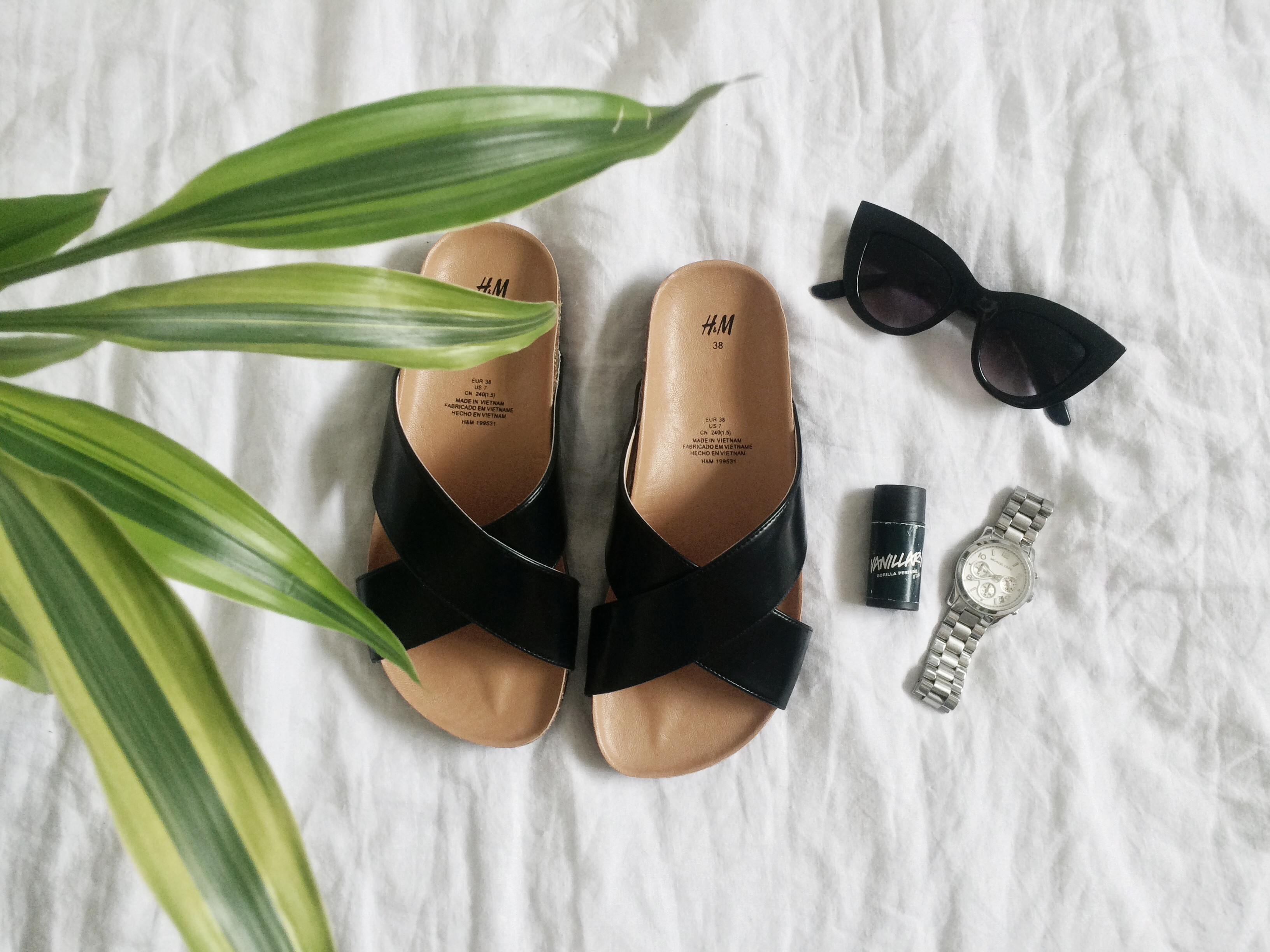 summer wardrobe essentials, cross strap sandals, isabel marant, dune, celine, birkenstock, dupe